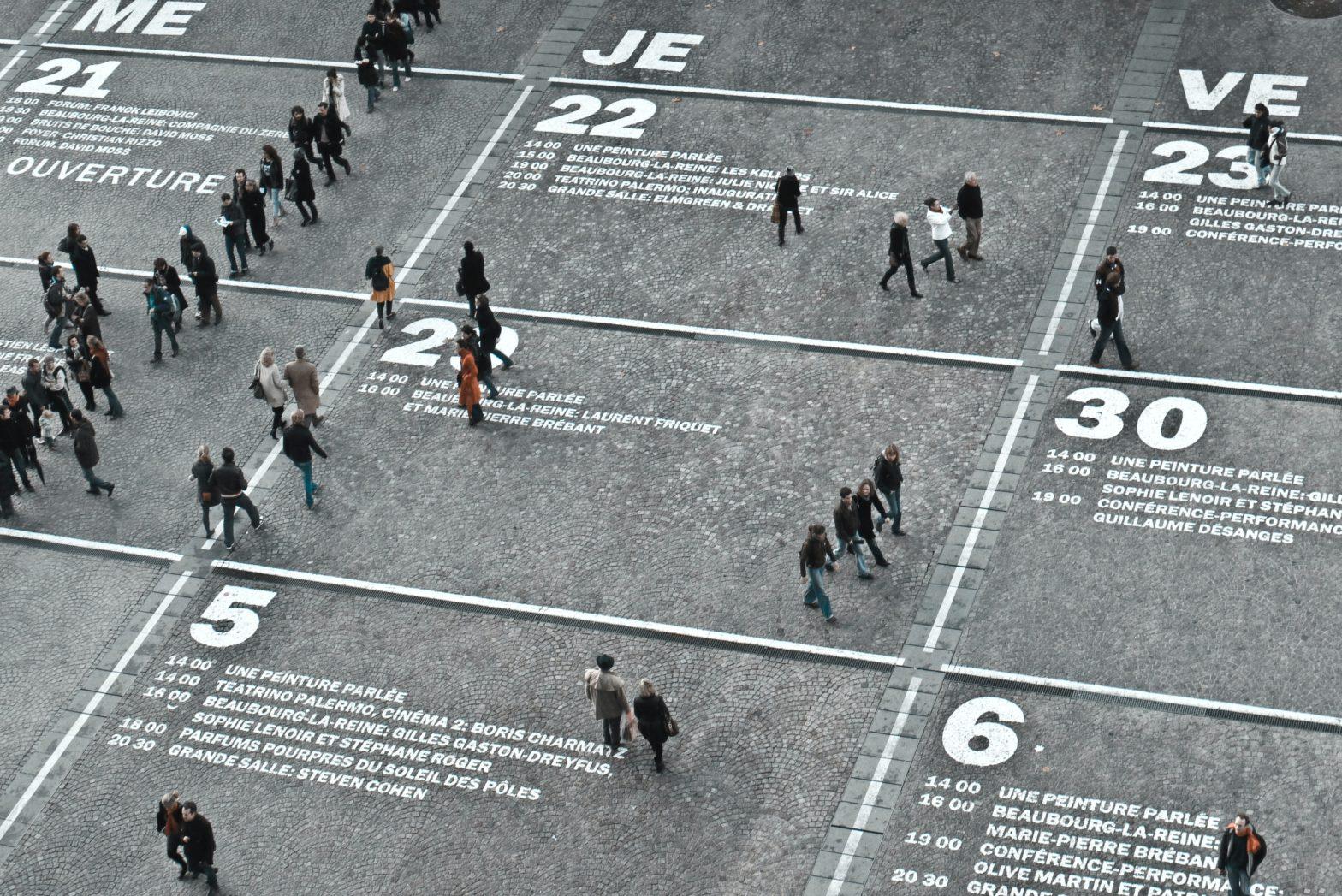 People walking on a calendar scheduler